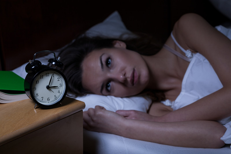 woman wide awake and can't sleep due to insomnia