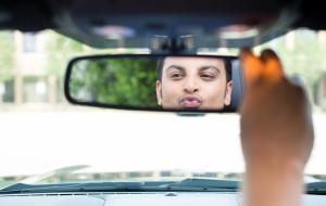 man admiring himself in the mirror