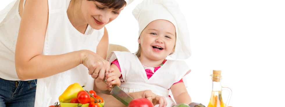 Mom and daughter preparing fresh vegetables and fruit